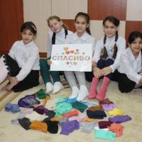 Die FALKE GRUPPE ermöglicht Kindern in Russland warme Füße